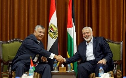 Palestinian Hamas Chief Ismail Haniyeh shakes hands with Egyptian intelligence chief Khaled Fawzi in visit to Gaza City October 3, 2017.