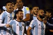 Argentina's Lionel Messi, Javier Mascherano (14) and other teammates celebrate at the end of the match.