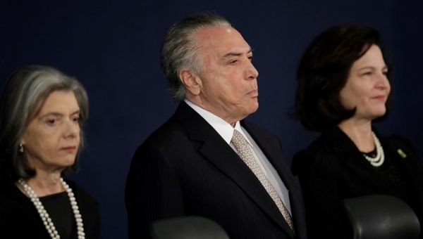 Supreme Court President Carmen Lucia (L), President Michel Temer (C) and new Attorney General Raquel Dodge (R) during a ceremony in Brasilia.