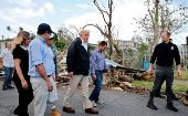 U.S. President Donald Trump walks past hurricane wreckage in Guaynabo, Puerto Rico, Oct. 3, 2017.