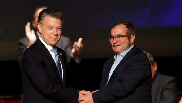 The Colombian President Juan Manuel Santos and FARC leader Rodrigo Londono, aka Timochenko, shake hands after signing the pact in Bogota, Colombia, November 24, 2016.