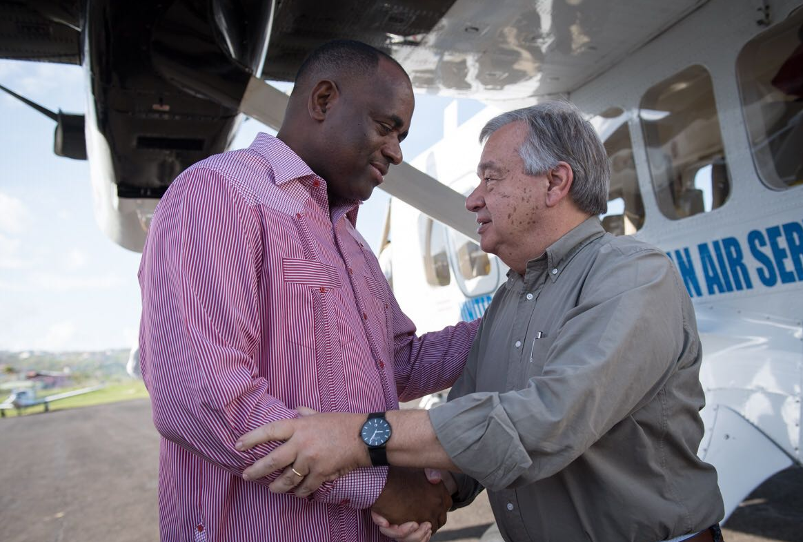 Dominica's President Roosevelt Skerrit (L) greets the UN Secretary General Antonio Guterres (R) during his visit to discuss the recovery efforts.
