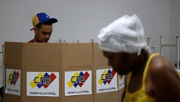 A man casts his vote at a polling station during the Constituent Assembly election in Caracas, Venezuela.