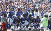 Orchard Park, NY, USA; Buffalo Bills players kneel in protest during the National Anthem before a game against the Denver Broncos at New Era Field. Sept. 24, 2017.