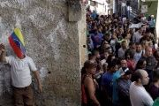 Venezuelans wait in line to vote in Sunday's gubernatorial elections.