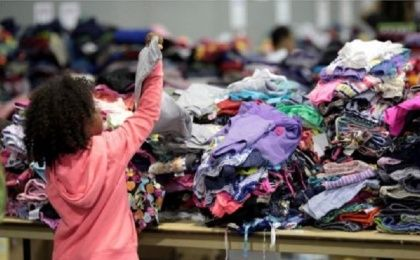 A child looks at donated clothes at a convention centre for Caribbean refugees whose homes were destroyed by Hurricane Irma, in San Juan, Puerto Rico.