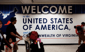 A family exits after clearing immigration and customs at Dulles International Airport in Dulles, Virginia, U.S. September 24, 2017.