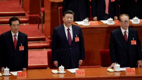 Former presidents Jiang Zemin and Hu Jintao sing the national anthem next to China