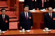 Former presidents Jiang Zemin and Hu Jintao sing the national anthem next to China's President Xi Jinping during the opening of the 19th National Congress of the Communist Party of China at the Great Hall of the People in Beijing, China October 18, 2017.