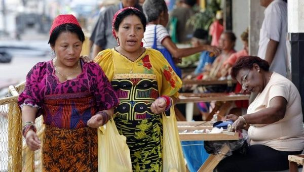 Indigenous women walk through the streets of Panama City.
