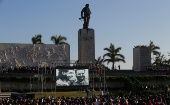 "Images of late Cuban President Fidel Castro (R) and revolutionary hero Ernesto ""Che"" Guevara (L) are seen during a ceremony commemorating the 50th anniversary of the death of Che Guevara."
