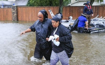 Families were forced to wade through the floodwaters to find shelter, Houston, U.S., August 28, 2017.
