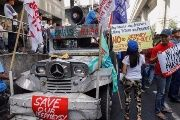 Activists and jeepney drivers hold banners during a jeepney transport strike held in Manila on October 16.