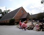 A volunteer helps clean up the damage at a Lutheran church in Dickinson, Texas.