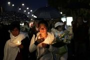 People hold candles as they march along the streets during a homage in memory of the victims who died in the earthquake on September 19, at Miramontes Coapa neighborhood in Mexico City, Mexico.