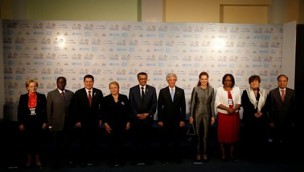 World leaders pose for a picture while attending a WHO Global Conference on non-communicable diseases in Montevideo, Uruguay.