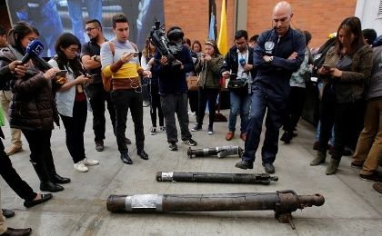A U.N. observer unloads weapons surrendered by the Revolutionary Armed Forces of Colombia (FARC), during the last session to disable firearms, in Funza, Colombia September 22, 2017.