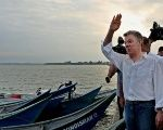 The Colombian President Juan Manuel Santos greets a fishing community during his visit to Tumaco, Narino, Colombia, October 21, 2017.
