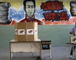 A woman casts her vote at a polling station in Caracas, Venezuela.