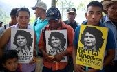 Indigenous Lenca hold posters of their indigenous leader and environmentalist, Berta Caceres, during a visit from Nobel Peace Prize winners Tawakkul Karman and Shirin Ebadi.