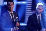 Real Madrid's Cristiano Ronaldo and Barcelona's Lionel Messi after being selected in the FIFA FIFPro World 11 during the awards.