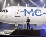 Prime Minister Dmitry Medvedev at the unveiling of the MC-21-300 aircraft.
