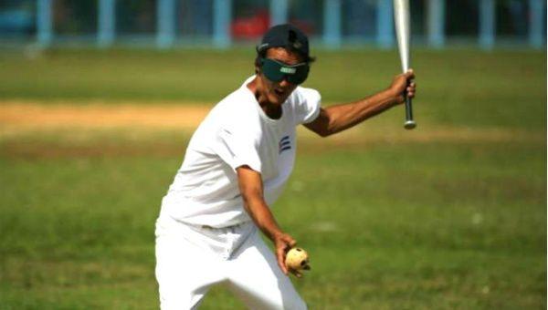 Gilberto Arteaga, who is visually impaired, participates in a baseball lesson at the Changa Medero stadium, in Havana, Cuba.