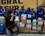 Members of a health brigade look at Bolivia's Health Minister Ariana Campero.