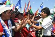 Evo Morales greets supporters during a rally.