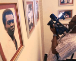 A videographer films images of Nigerian music legend Fela Kuti during the opening of a museum in his honour in Lagos October 15, 2012.