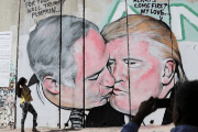 A massive mural of Israeli Prime Minister Benjamin Netanyahu and US President Donald Trump engaged in a passionate kiss was unveiled Sunday morning, October 29, 2017, painted on the West Bank security barrier near the West Bank city of Bethlehem.