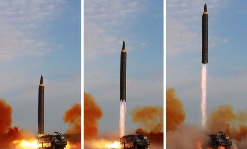 North Korean leader Kim Jong Un (not pictured) guides the launch of a Hwasong-12 missile in this undated combination photo released by North Korea