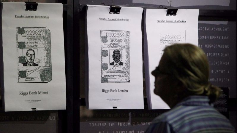 A man reads files of recently declassified CIA documents that show U.S. involvement in Pinochet