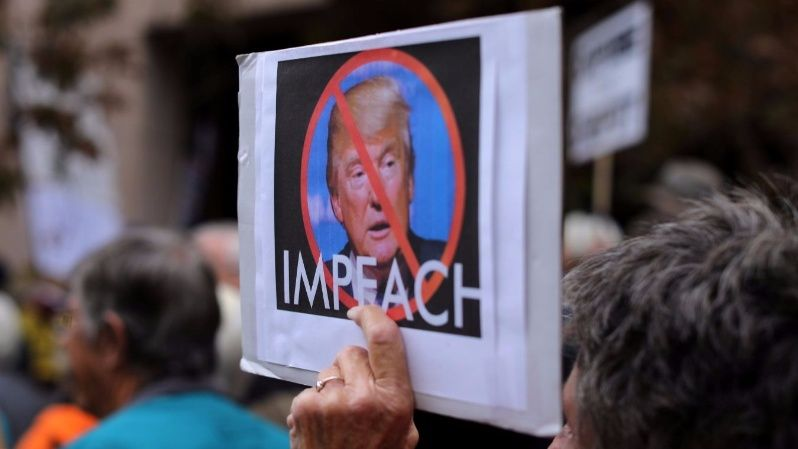 Demonstrator protest against U.S. President Donald Trump and Republican congressman Darrell Issa (R-Vista) outside Issa