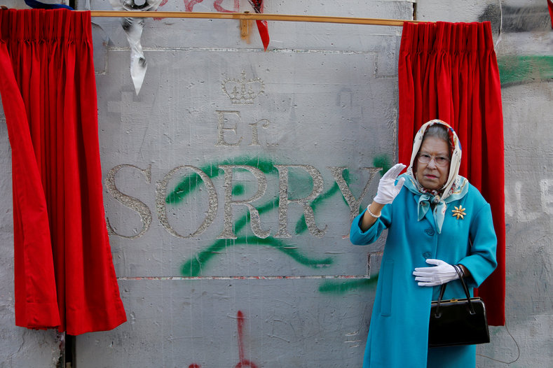 A Palestinian protester dressed up as Queen Elizabeth.