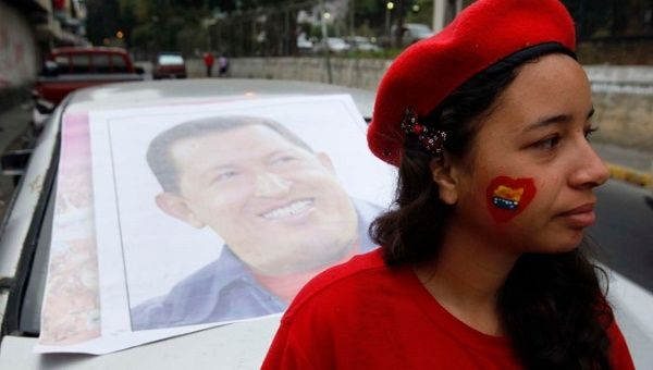 A supporter of former Venezuelan President Hugo Chavez stands outside a military hospital.