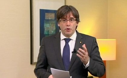 Sacked Catalan President Carles Puigdemont makes a statement calling for the release of