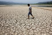 A man walks along the dried-up bed of a reservoir in Sanyuan county, in China's Shaanxi province.