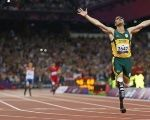 Oscar Pistorius of South Africa celebrates winning the Men's 400m T44 Final during the London 2012 Paralympic Games.