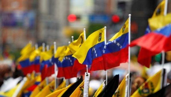 Venezuelan flags are seen during a rally in Caracas, Venezuela.