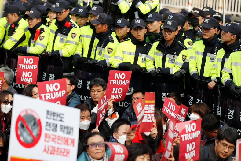Protesters against U.S. President Donald Trump wait for Trump