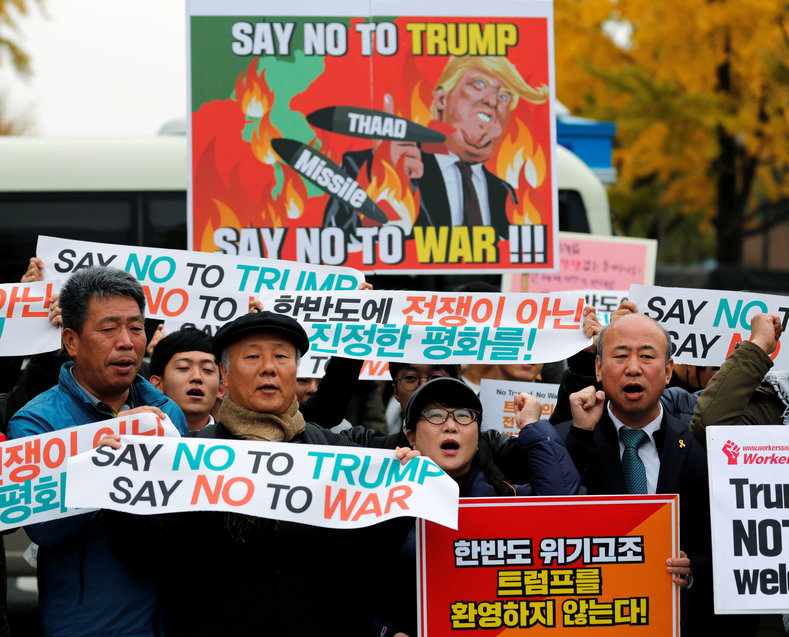 Protesters take part in a rally against U.S. President Donald Trump near South Korea