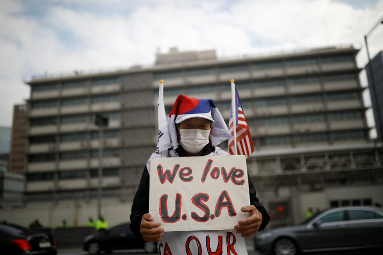 A protester from a far-right civic group stands in front of U.S. embassy in central Seoul, South Korea, Nov. 6, 2017.