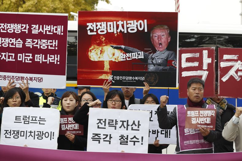 South Korean protesters shout slogans during a rally held to show opposition to the U.S. President