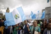 People carry Guatemalan flags while celebrating at constitution square as Guatemala's former president Otto Perez Molina attends a hearing at the Supreme Court of Justice, in Guatemala City, September 3, 2015.
