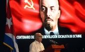 José Ramón Macado Ventura, the Second Secretary of the Cuban Communist Party Central Committee speaks in front of a picture of Bolshevik leader Vladimir Lenin.