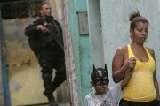 A Brazilian security official patrols a working-class neighborhood.