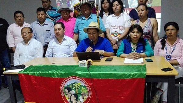 Luis Fernando Arias, spokesman for the Indigenous National Organization of Colombia, reads a statement after the signing of an agreement with the government.