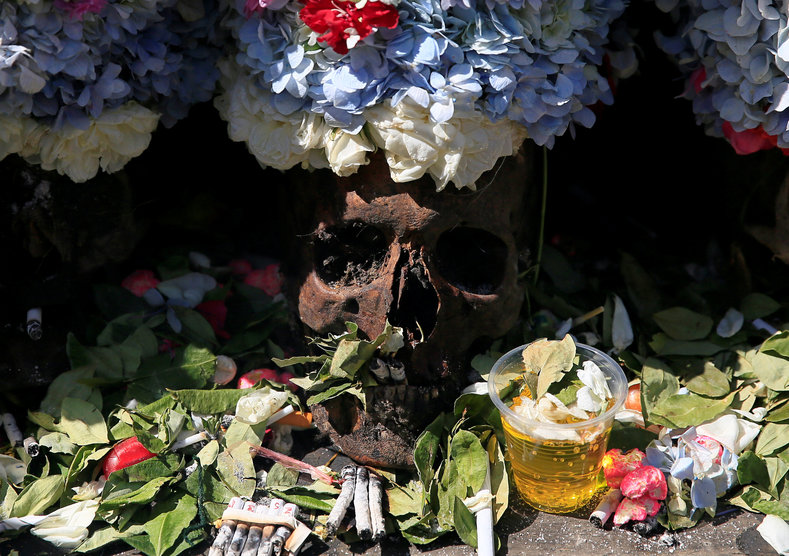 Skulls are adorned with flowers as a way of honoring the dead, and bringing good fortune.