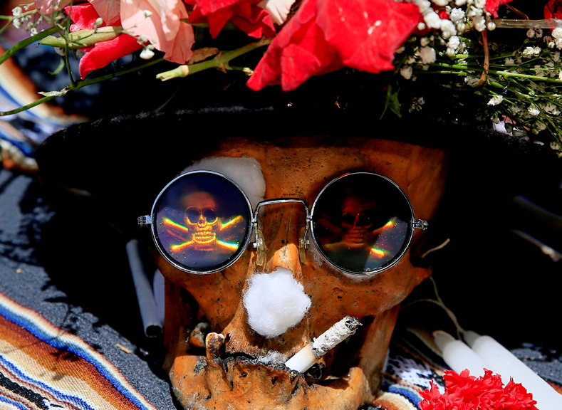 "A skull ""smokes"" a cigarette as it is prepared to be marched to the cemetery."